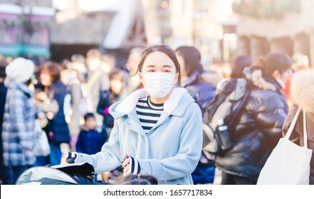 Coronavirus Covid19 virus and pm2.5 concept.Japanese mother with kids wearing mask for protect pm2.5 and Covid-19 virus outdoor at Tokyo.Social distancing coronavirus and pandemic virus symptoms.