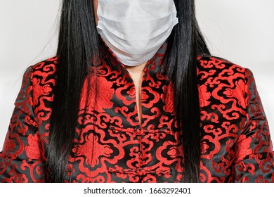 Coronavirus COVID-19 world outbreak concept with female wearing mask. Woman dressed in Asian clothes, wears face mask to protect from 2019-nCoV virus and respiratory diseases.