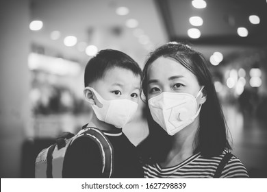 Coronavirus covid-19.Asian tourism kid toddler boy with mother mask for protect coronavirus back to school.vaccinated family at airport.Digital health passport certificate for travel during covid19.