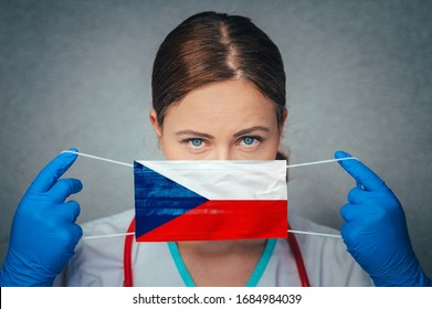 Coronavirus in Czechia, Czech Republic Female Doctor Portrait hold protect Face surgical medical mask with Czech Republic National Flag. Illness, Virus Covid-19 in Czech Republic, concept photo - Shutterstock ID 1684984039