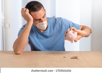 Coronavirus. Depressed and worried business man because impact on retail businesses shut down causing unemployment financial distress. Save money. Quarantine. Isolated. Piggy bank.