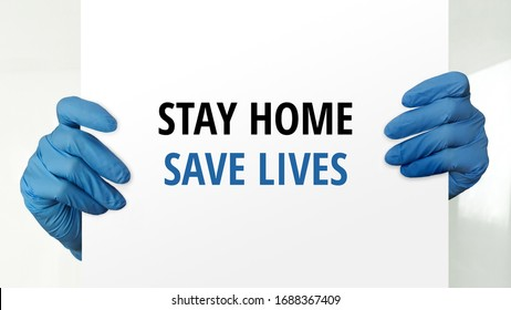Coronavirus disease, COVID-19, social distancing, quarantine, self-quarantine, self-isolation concept. Stay home, save lives. Doctor's hands with blue protective  gloves holding paper with message.