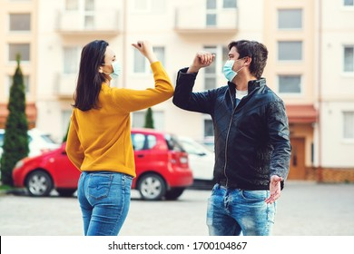 Coronavirus epidemic. Guy and girl greeting with elbows. Coronavirus quarantine. World global pandemic. Friends shaking elbows. People maintain social distancing to prevent from virus spreading.