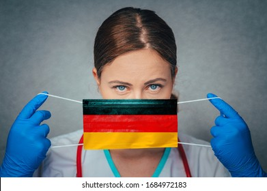 Coronavirus in Germany, Deutschland Female Doctor Portrait hold protect Face surgical medical mask with Germany National Flag. Illness, Virus Covid-19 in Germany, concept photo
