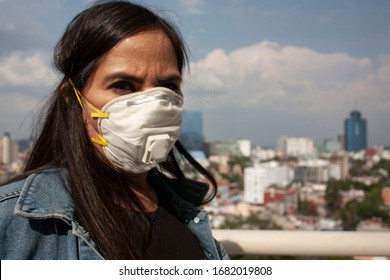 Coronavirus Long-haired Mexican woman sick with influenza, coronavirus, bacteria wearing a face mask in Mexico City to avoid  contagion  between 40 and 45 years h1n1 virus