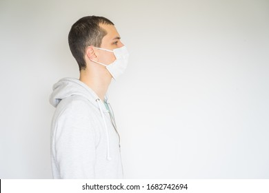 coronavirus, a man in a mask on a white background. Title about the outbreak of the corona virus in China, illness. Epidemic