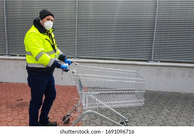 coronavirus : man with medical mask and gloves are waiting with shopping cart out of the supermarket