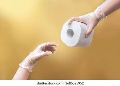 Coronavirus meme concept: creation of Adam like hands holding toilet paper wearing latex gloves on beige background