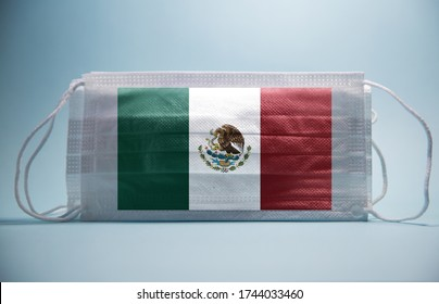 Coronavirus in Mexic Concept.Dramatic atmosphere Mexican Flag printed on surgical protective mask.Impact of pandemic virus on Mexican economy.Covid -19 spread around mexic and rest of world.covid-19