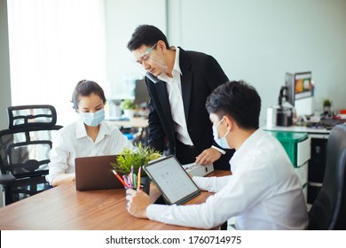 Coronavirus Office workers with mask for corona virus. Business workers wear masks to protect and take care of their health. Office working with computer. - Shutterstock ID 1760714975