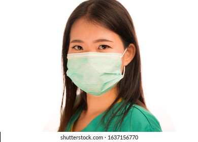 Coronavirus outbreak in China - young beautiful Asian Chinese medicine doctor woman or hospital nurse in scrubs using protective medical face mask in prevention against virus infection