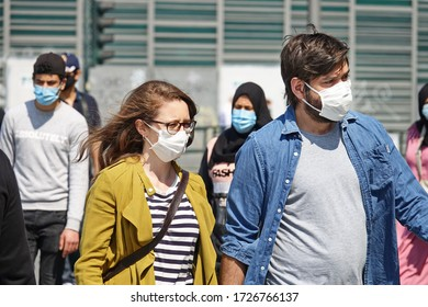 Coronavirus outbreak lifestyle: obligation to wear the masks outdoors. Paris, France - May 2020