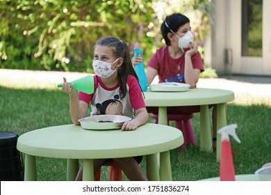 Coronavirus outbreak lifestyle:  outdoor summer school activities with social distancing measures. Turin, Italy - June 2020