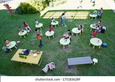 Coronavirus outbreak lifestyle:  outdoor summer school activities with social distancing measures. Turin, Italy - June 2020