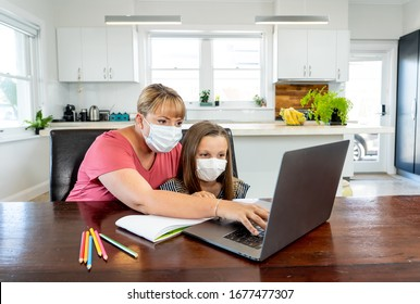 Coronavirus Outbreak. Lockdown and school closures. Mother helping bored daughter with face mask studying online classes at home. COVID-19 pandemic forces children and teachers online learning. - Shutterstock ID 1677477307