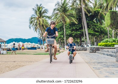 Coronavirus is over. Quarantine weakened. Take off the mask. Now you can go to public places. Happy family is riding bikes outdoors and smiling. Father on a bike and son on a balancebike