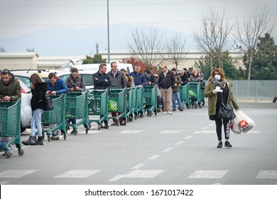 Coronavirus pandemic effects: long queue to enter the supermarket for grocery shopping. Milan, Italy - March 2020