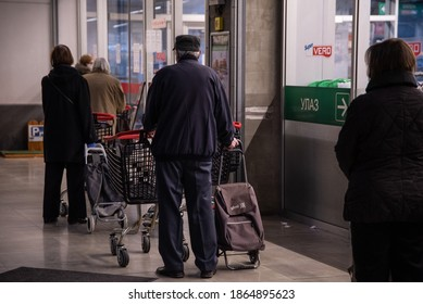 Coronavirus pandemic effects: Pensioner and senior citizen stand in long queues to enter the supermarket for grocery shopping in panic. Corona virus, Covid-19. Belgrade, Serbia - 04.04.2020