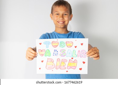 Coronavirus pandemic self quarantine in Spain. Kids at home drawing pictures with spanish words Todo va a salir bien - Everything will be fine