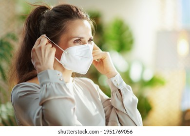 coronavirus pandemic. trendy woman in grey blouse wearing ffp2 mask.