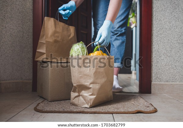 Coronavirus. Quarantine, contactless delivery during a pandemic covid. Stay at home, Online shopping. Food boxes and stamp. Contactless delivery.
