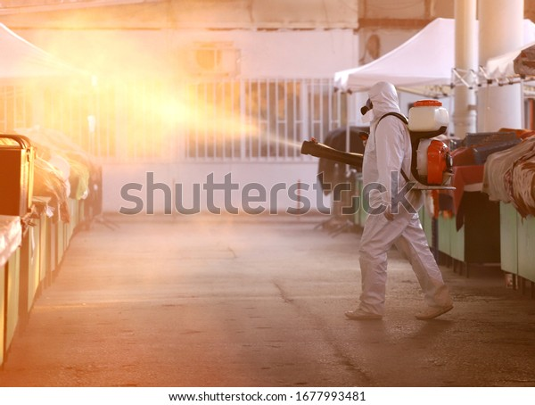 Coronavirus Quarantine. Disinfection, decontamination and spraying on a public place as a prevention against Coronavirus disease 2019, COVID-19. State of emergency over coronavirus.