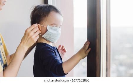 Coronavirus quarantine. Kids stay at home, Distance learning online education. Social isolation. Medical masks.
