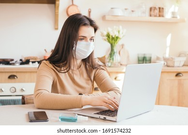 Coronavirus. Quarantine. Online training, education and freelance work. Computer, laptop and girl study remotely at home in the kitchen. Coronavirus pandemic in the world. School closure.