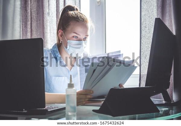 Coronavirus. Quarantine. Online training education and freelance work. Computer, laptop and girl studying remotely. Coronavirus pandemic  in the world. Closing schools
