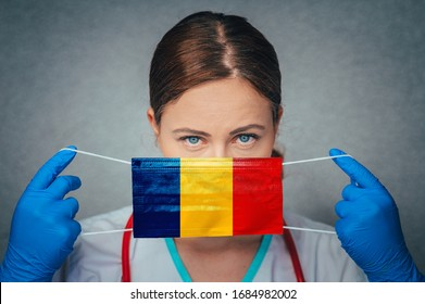 Coronavirus in Romania Female Doctor Portrait hold protect Face surgical medical mask with Romania National Flag. Illness, Virus Covid-19 in Romania, concept photo