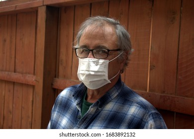 Coronavirus. Sick man with corona virus wearing mask protection recovering from the illness in home. Quarantine. Patient isolated to prevent infection.
