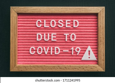 Coronavirus store closure sign. Closed due to COVID-19 message board for retail business COVID-19 pandemic outbreak. Government shutdown of restaurants, bakeries, non essential services. Pink letters. - Shutterstock ID 1711241995