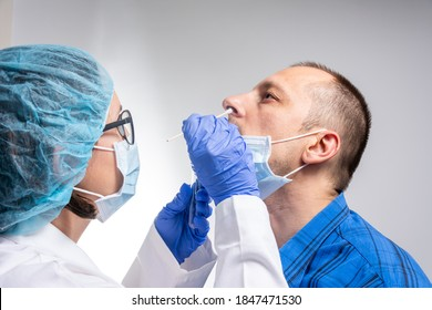 Coronavirus test - Medical worker taking a swab for corona virus sample from potentially infected man. covid-19 nasal swab test - doctor taking a mucus sample from patient nose in hospital
