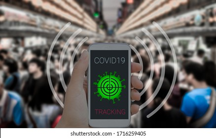 Coronavirus tracking application to reduce coronavirus spreading after quarantine detecting infected people. Phone with app in caucasian female hands against purposely blurred crowd in background
