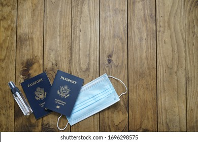 Coronavirus travel concept. Face Mask Medical Protective and USA Passport.Covid-19 novel coronavirus outbreak on white background.Protect Coronavirus,Covid-19 and pm 2.5. On Wooden table. Copy space