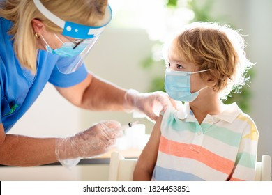 Coronavirus vaccination. Covid-19 vaccine. Doctor vaccinating child. Kids at clinic. Little boy getting flu shot. Pediatrician examining kid and giving injection. Virus prevention. Health care.