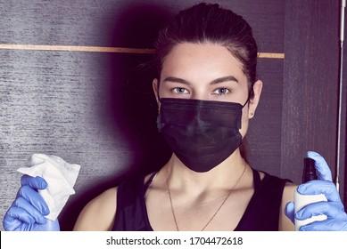 Coronavirus. Woman in quarantine for coronavirus wearing protective mask and plastic gloves.