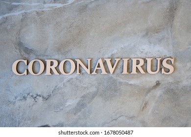 coronavirus  word written on wooden letters.  coronavirus  text on stone table for your desing, coronavirus concept top view.