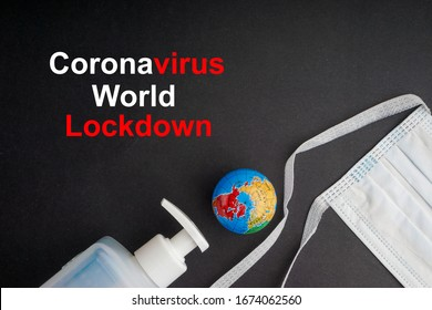 CORONAVIRUS WORLD LOCKDOWN text with antibacterial soap sanitizer and protective face mask on black background. Covid-19 or Coronavirus Concept