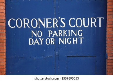 coroners court no parking day or night blue wooden gates dublin city morgue