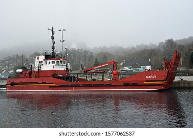 Corpach, Scotland/UK - December 1 2019: Ferguson Shipping boat on Caledonian Canal at Corpach, Scotland on route of Great Glen Way long distance walking and cycling route