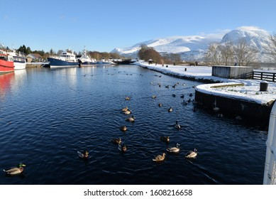 Corpach Sea Lock, Fort William, the entrance to the Caledonian Canal, in winter with snow covered mountain Ben Nevis in background