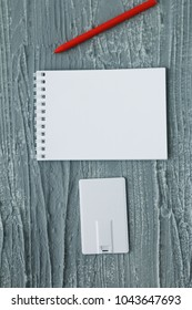 Corporate branding mockup template, isolated on wooden and leather background.