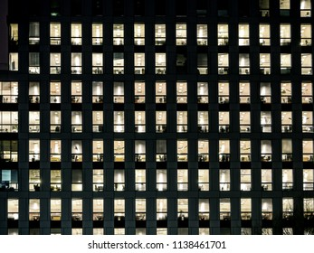 Corporate building exterior in the late eveing with interior lights on