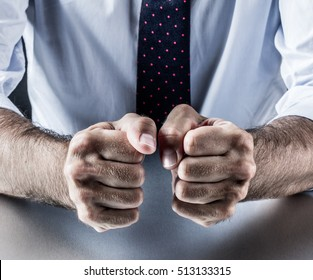 corporate or business hand gesture for symbol of courage, power, conviction, union or impatience with both fists together for positive management communication