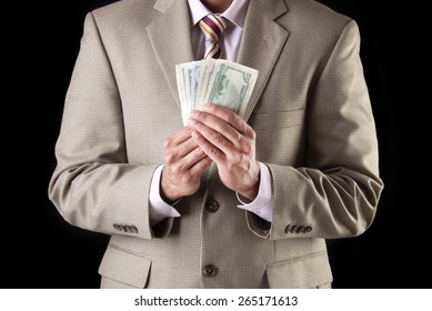 Corporate business man showing and counting money, american dollars