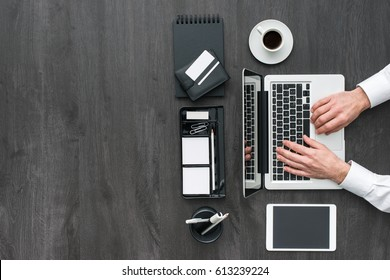 Corporate business manager working at office desk, he is using a laptop, technology and communication concept, flat lay
