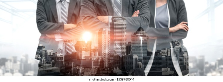 Corporate business partner stand in city background showing partnership and teamwork. The three business partner work as corporate business to utilize strength of their partnership .