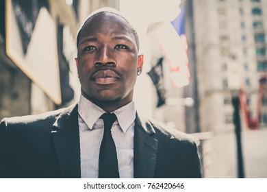 Corporate businessman portrait - Confident business man walking in wall street