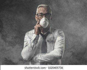 Corporate businessman wearing a protective mask for air pollution, business and environmental care concept